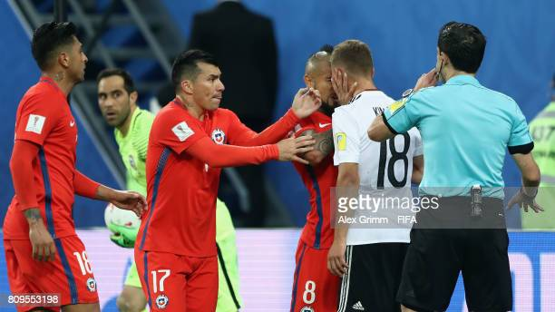 Joshua Kimmich of Germany clashes with Arturo Vidal of Chile during the FIFA Confederations Cup Russia 2017 final between Chile and Germany at Saint...
