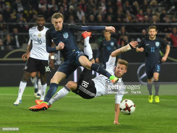 Joshua Kimmich of Germany clashes with Jamie Vardy of England during the international friendly match between Germany and England at Signal Iduna...