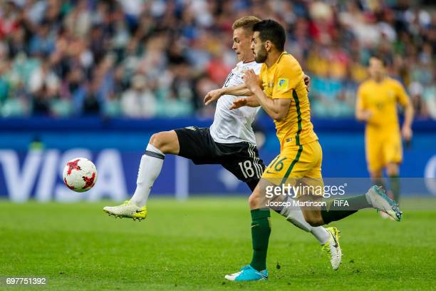 Joshua Kimmich of Germany competes with Aziz Behich of Australia during the FIFA Confederations Cup Russia 2017 group B football match between...