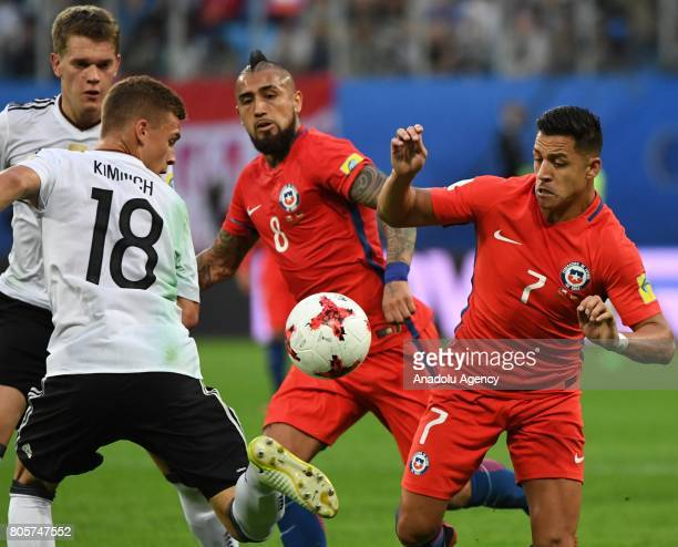 Joshua Kimmich of Germany in action against Arturo Vidal and Alexis Sanchez of Chile during the Confederations Cup 2017 Final match Chile Germany at...