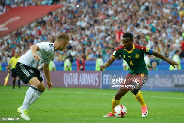 Joshua Kimmich of Germany in action against Benjamin Moukandjo of Cameroon during the FIFA Confederations Cup 2017 soccer match between Cameroon and...