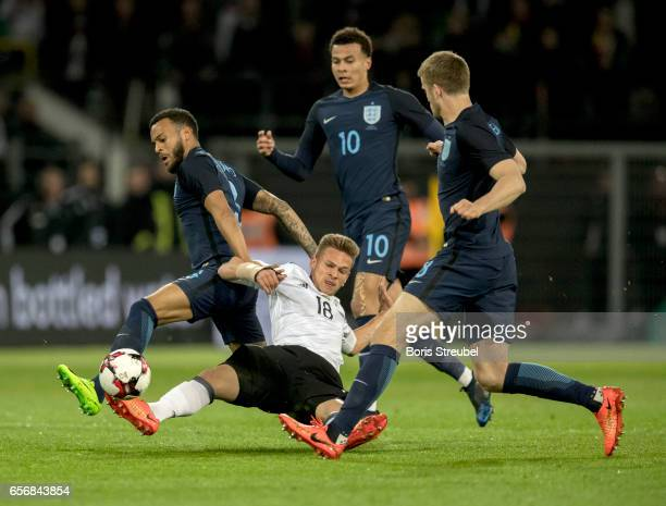 Joshua Kimmich of Germany is challenged by Ryan Bertrand Dele Alli and Eric Dier of England during the international friendly match between Germany...