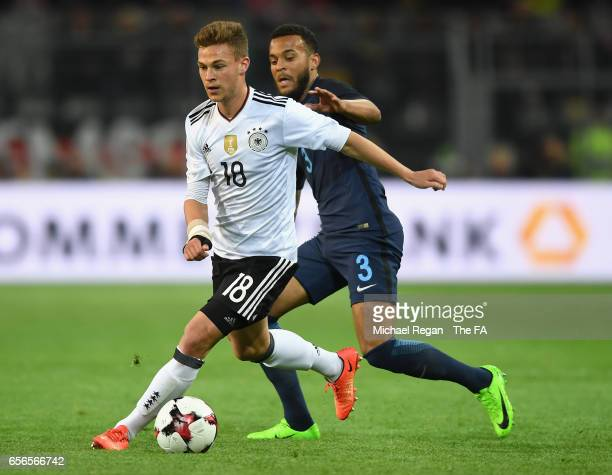 Joshua Kimmich of Germany is put under pressure from Ryan Bertrand of England during the international friendly match between Germany and England at...