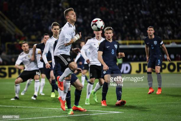Joshua Kimmich of Germany jumps during to the international friendly match between Germany and England at Signal Iduna Park on March 22 2017 in...