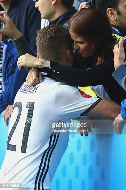 Joshua Kimmich of Germany kisses his girlfriend Lina Meyer after the UEFA EURO 2016 round of 16 match between Germany and Slovakia at Stade...