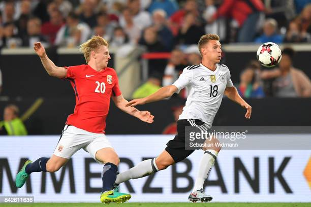 Joshua Kimmich of Germany runs against Mats Moller Daehli of Norway during the FIFA 2018 World Cup Qualifier between Germany and Norway at...