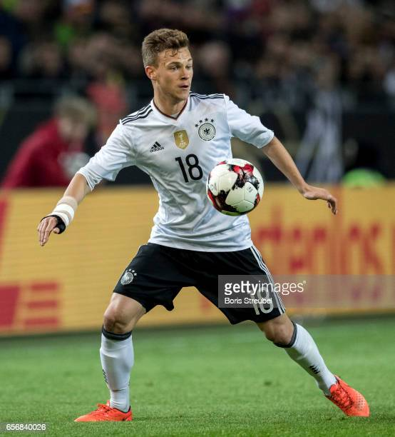 Joshua Kimmich of Germany runs with the ball during the international friendly match between Germany and England at Signal Iduna Park on March 22...