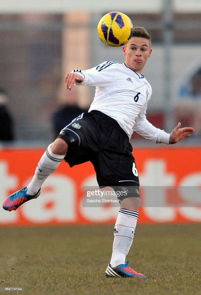 Joshua Kimmich of Germany runs with the ball during the U18 International Friendly match between The Netherlands and Germany on March 26, 2013 in Vriezenveen, Netherlands.