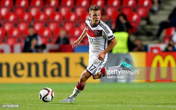Joshua Kimmich of Germany runs with the ball during the UEFA European Under21 Group A match between Germany and Denmark at Eden Stadium on June 20...