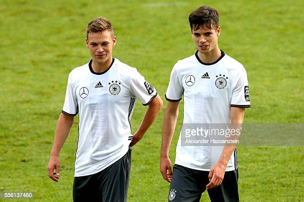 Joshua Kimmich of Germany talks to his team mate Julian Weigl during a training session at Stadio communale on day 8 of the German national team...