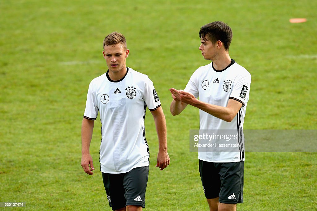 <a gi-track='captionPersonalityLinkClicked' href=/galleries/search?phrase=Joshua+Kimmich&family=editorial&specificpeople=9479434 ng-click='$event.stopPropagation()'>Joshua Kimmich</a> (L) of Germany talks to his team mate Julian Weigl during a training session at Stadio communale on day 8 of the German national team trainings camp on May 31, 2016 in Ascona, Switzerland.