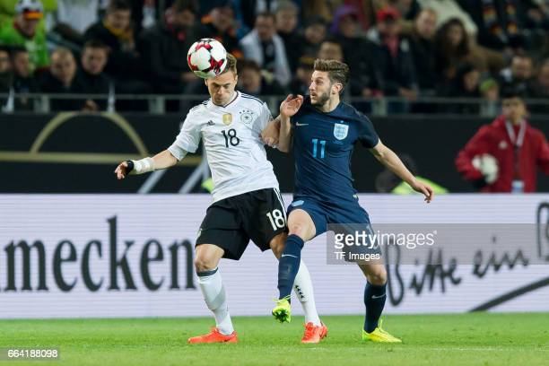 Joshua Kimmich of Germany und Adam Lallana battle for the ball during the international friendly match between Germany and England at Signal Iduna...