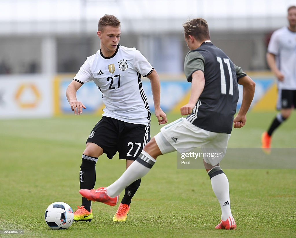 <a gi-track='captionPersonalityLinkClicked' href=/galleries/search?phrase=Joshua+Kimmich&family=editorial&specificpeople=9479434 ng-click='$event.stopPropagation()'>Joshua Kimmich</a> (L) of Germany vies with Felix Lohkemper of Germany U20 during a friendly match as part of their training camp on May 26, 2016 in Ascona, Switzerland.