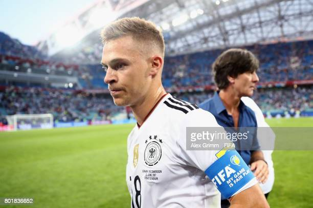 Joshua Kimmich of Germany walks past head coach Joachim Loew after the FIFA Confederations Cup Russia 2017 Group B match between Germany and Cameroon...