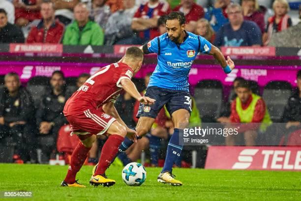 Joshua Kimmich of Muenchen and Karim Bellarabi of Leverkusen battle for the ball during the Bundesliga match between FC Bayern Muenchen and Bayer 04...
