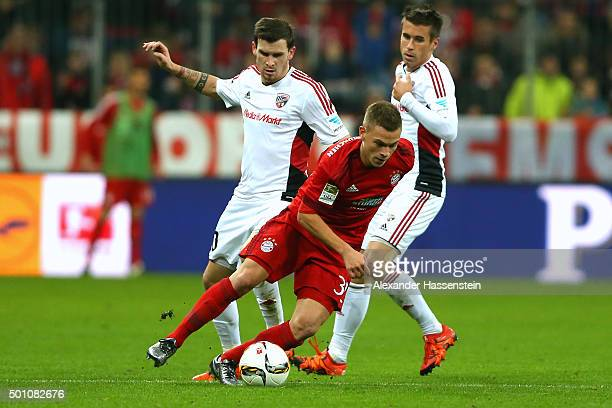 Joshua Kimmich of Muenchen battles for the ball with Pacal Gross of Ingolstadt and his team mate Stefan Lex during the Bundesliga match between FC...