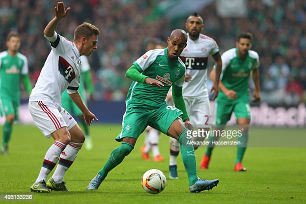 Joshua Kimmich of Muenchen battles for the ball with Theodor Gebre Selassie of Bremen during the Bundesliga match between SV Werder Bremen and FC...