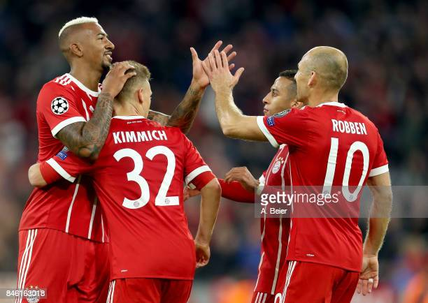 Joshua Kimmich of Muenchen celebrate with team mate Jerome Boateng after he scores the 3rd goal during the UEFA Champions League group B match...