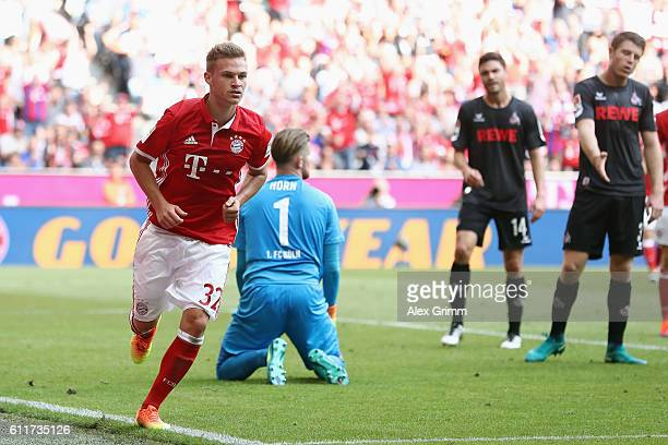 Joshua Kimmich of Muenchen celebrates his team's first goal during the Bundesliga match between Bayern Muenchen and 1 FC Koeln at Allianz Arena on...