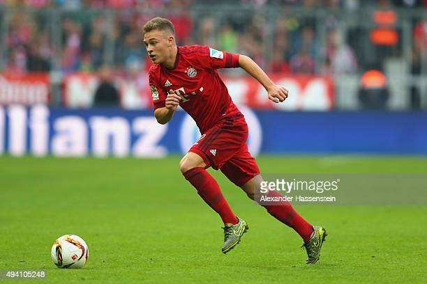 Joshua Kimmich of Muenchen runs with the ball during the Bundesliga match between FC Bayern Muenchen and 1 FC Koeln at Allianz Arena on October 24...
