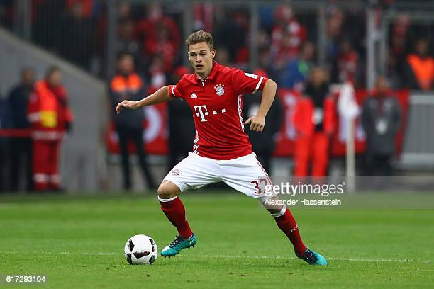 Joshua Kimmich of Muenchen runs with the ball during the Bundesliga match between Bayern Muenchen and Borussia Moenchengladbach at Allianz Arena on...