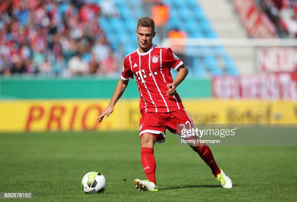 Joshua Kimmich of Muenchen runs with the ball during the DFB Cup first round match between Chemnitzer FC and FC Bayern Muenchen at community4you...