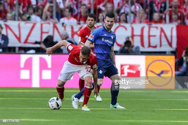 Joshua Kimmich of Munich and Jerome Gondorf of Darmstadt battle for the ball during the Bundesliga match between Bayern Muenchen and SV Darmstadt 98...