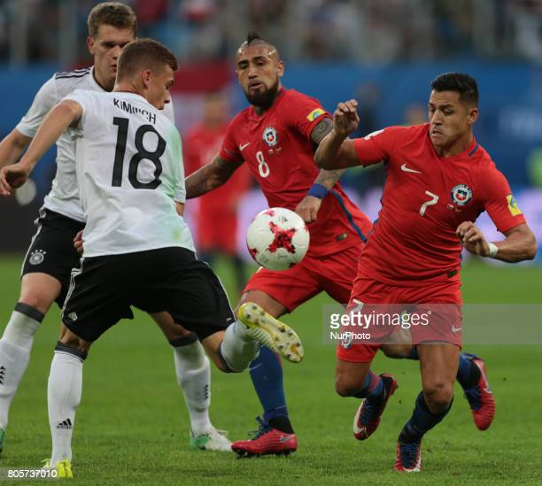 Joshua Kimmich of the Germany national football team and Arturo Vidal Alexis Sanchez of the Chile national football team vie for the ball during the...