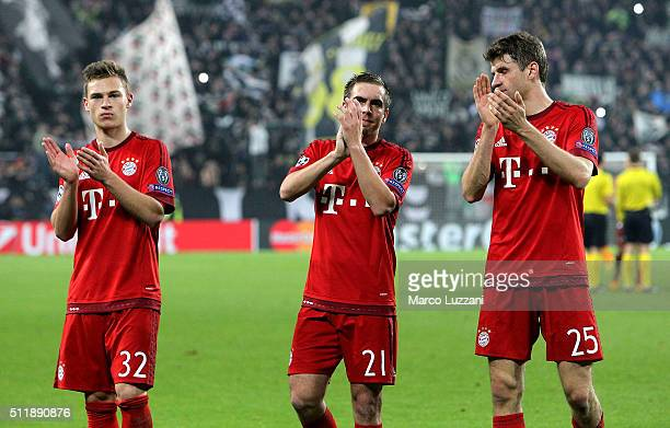 Joshua Kimmich Philipp Lahm and Thomas Muller of FC Bayern Muenchen salute the fans at the end of the UEFA Champions League Round of 16 first leg...