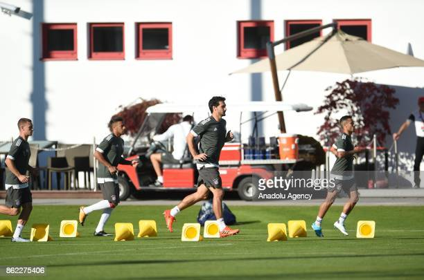 Joshua Kimmich Rafinha Mats Hummels and Thiago of FC Bayern Munich attend a training session ahead of the Champions League group B match between...