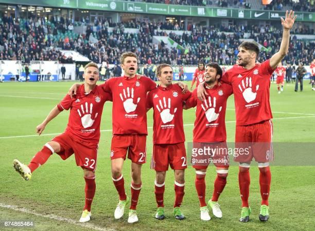 Joshua Kimmich Thomas Mller Philipp Lahm Juan Bernat and Juan Bernat of Muenchen celebrate winning the Bundesliga title after the Bundesliga match...