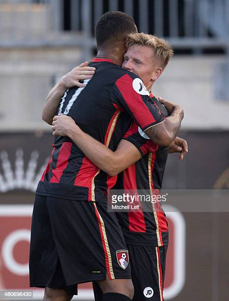 Joshua King and Matt Ritchie of AFC Bournemouth celebrate after a goal by Joshua King in the first half of the friendly match against the...