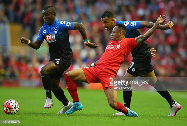 Joshua King and Max Gradel of Bournemouth battle with Nathaniel Clyne of Liverpool during the Barclays Premier League match between Liverpool and AFC...