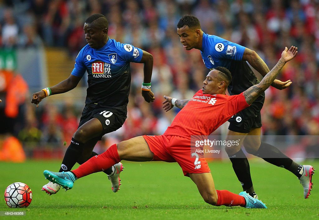 Joshua King (R) and <a gi-track='captionPersonalityLinkClicked' href=/galleries/search?phrase=Max+Gradel&family=editorial&specificpeople=5488968 ng-click='$event.stopPropagation()'>Max Gradel</a> of Bournemouth (L) battle with <a gi-track='captionPersonalityLinkClicked' href=/galleries/search?phrase=Nathaniel+Clyne&family=editorial&specificpeople=5738873 ng-click='$event.stopPropagation()'>Nathaniel Clyne</a> of Liverpool (C) during the Barclays Premier League match between Liverpool and A.F.C. Bournemouth at Anfield on August 17, 2015 in Liverpool, United Kingdom.