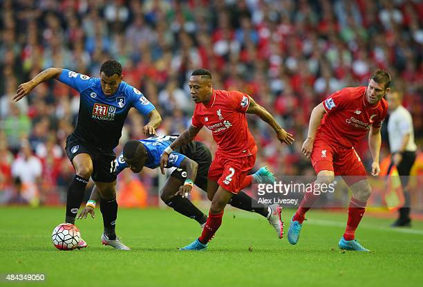 Joshua King and Max Gradel of Bournemouth take on Nathaniel Clyne and James Milner of Liverpool during the Barclays Premier League match between...