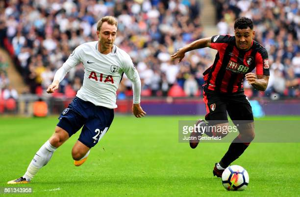 Joshua King of AFC Bournemouth and Christian Eriksen of Tottenham Hotspur during the Premier League match between Tottenham Hotspur and AFC...
