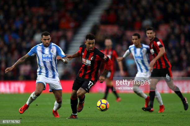 Joshua King of AFC Bournemouth and Danny Williams of Huddersfield Town compete for the ball during the Premier League match between AFC Bournemouth...