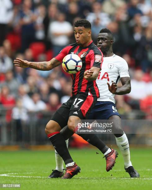 Joshua King of AFC Bournemouth and Davinson Sanchez of Tottenham Hotspur battle for possession during the Premier League match between Tottenham...