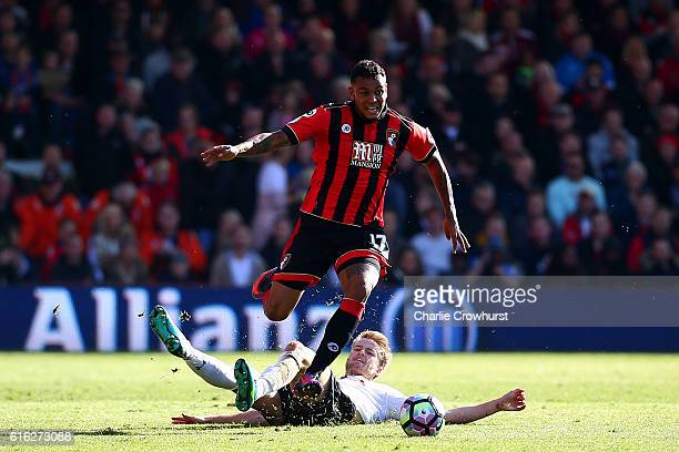 Joshua King of AFC Bournemouth and Eric Dier of Tottenham Hotspur compete for the ball during the Premier League match between AFC Bournemouth and...
