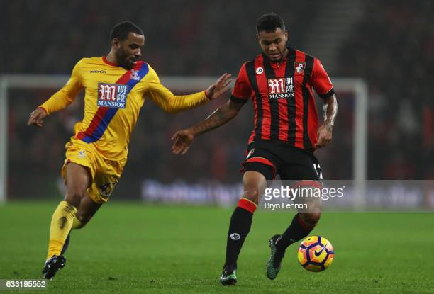 Joshua King of AFC Bournemouth and Jason Puncheon of Crystal Palace compete for the ball during the Premier League match between AFC Bournemouth and...
