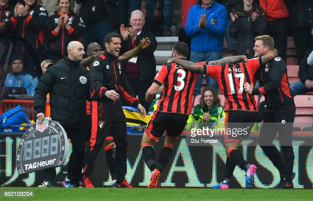Joshua King of AFC Bournemouth celebrates as he scores their third goal and completes his hat trick with Steve Cook and Eddie Howe manager of AFC...