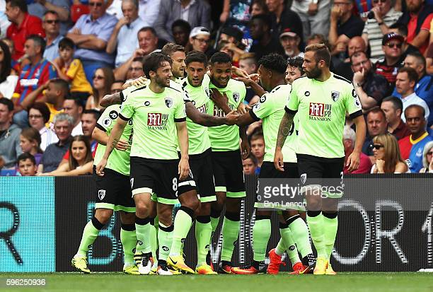 Joshua King of AFC Bournemouth celebrates scoring his sides first goal with team mates during the Premier League match between Crystal Palace and AFC...