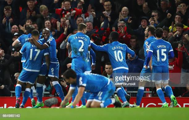 Joshua King of AFC Bournemouth celebrates scoring his sides second goal with his AFC Bournemouth team mates during the Premier League match between...