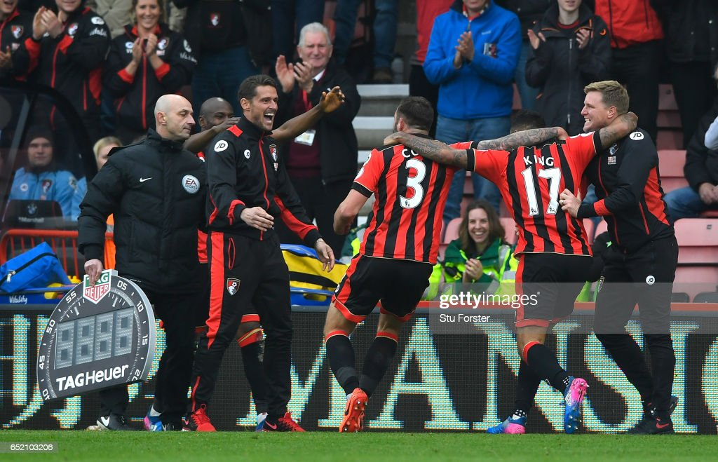 Joshua King of AFC Bournemouth (C) celebrates scoring his sides third goal with Steve Cook of AFC Bournemouth (L) and Eddie Howe, Manager of AFC Bournemouth (R) during the Premier League match between AFC Bournemouth and West Ham United at Vitality Stadium on March 11, 2017 in Bournemouth, England.