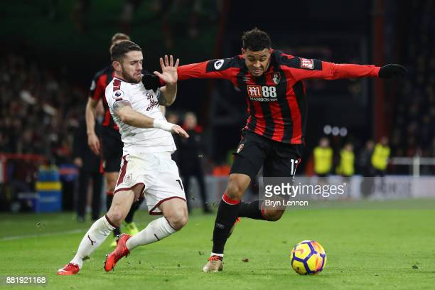 Joshua King of AFC Bournemouth is challenged by Robbie Brady of Burnley during the Premier League match between AFC Bournemouth and Burnley at...