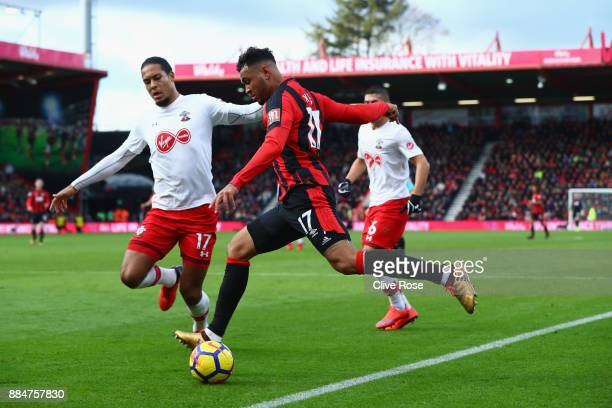 Joshua King of AFC Bournemouth is challenged by Virgil van Dijk of Southampton during the Premier League match between AFC Bournemouth and...