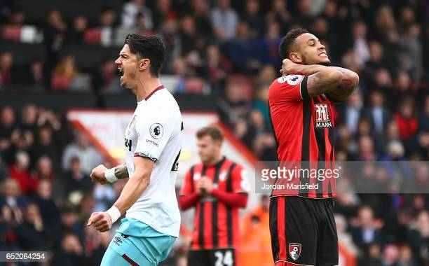 Joshua King of AFC Bournemouth reacts to missing a penalty during the Premier League match between AFC Bournemouth and West Ham United at Vitality...