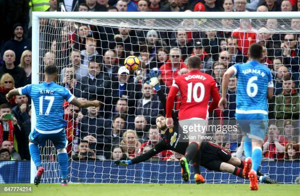 Joshua King of AFC Bournemouth scores his sides first goal from the penalty spot past David De Gea of Manchester United during the Premier League...