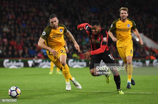 Joshua King of AFC Bournemouth takes on Shane Duffy of Brighton and Hove Albion during the Premier League match between AFC Bournemouth and Brighton...
