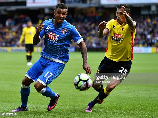 Joshua King of AFC Bournemouth takes the ball past Jose Holebas of Watford during the Premier League match between Watford and AFC Bournemouth at...